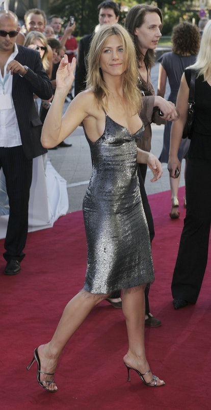 Jennifer Aniston wearing a gunmetal sequin knee-length dress at the 2006 press tour for The Breakup.