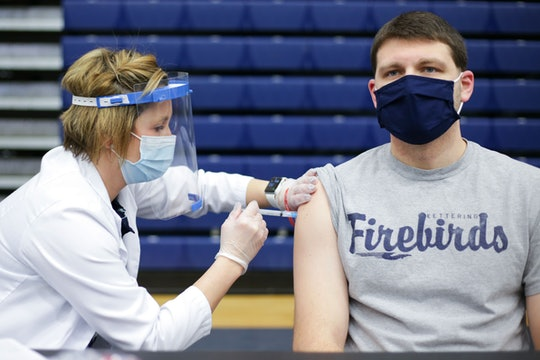 Educational staff at Kettering City Schools receive the Covid-19 vaccine as a part of Ohios Phase 1B vaccine distribution in Dayton, Ohio, on February 10, 2021. (Photo by MEGAN JELINGER / AFP) (Photo by MEGAN JELINGER/AFP via Getty Images)