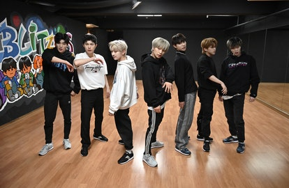 This picture taken on April 29, 2021 shows members of the K-pop boy band Blitzers performing during ...