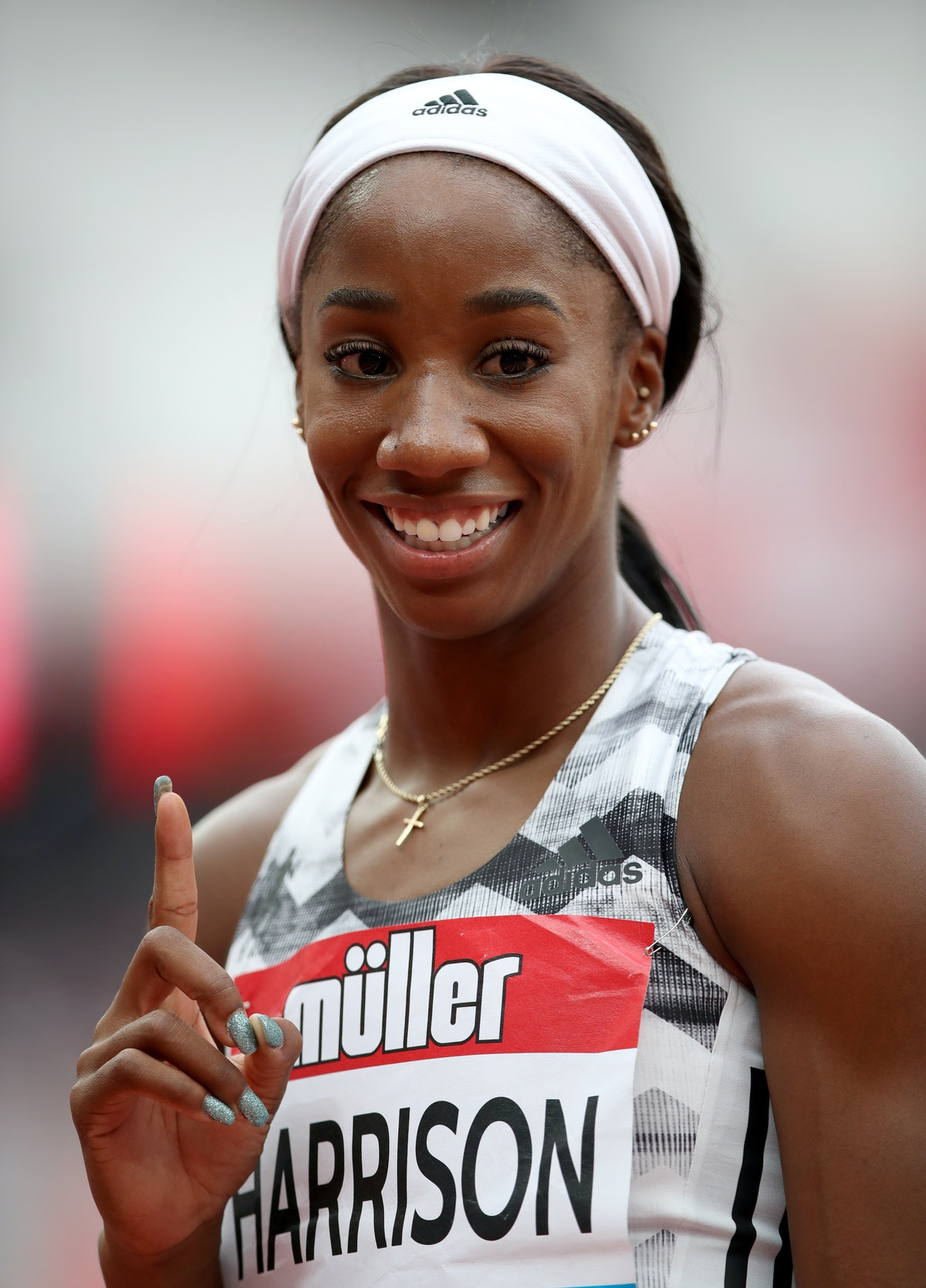USA's Kendra Harrison celebrates after winning the Women's 100m hurdles during day two of the Muller...
