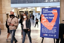 NEW YORK, NEW YORK - MAY 12: People walk through Grand Central Terminal where a pop-up site for COVI...