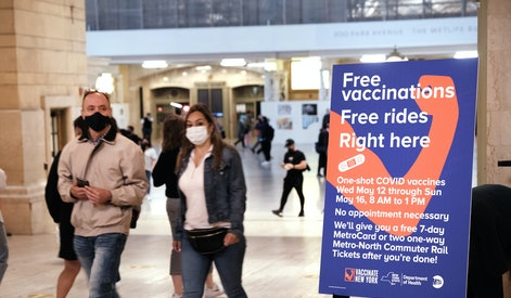 NEW YORK, NEW YORK - MAY 12: People walk through Grand Central Terminal where a pop-up site for COVID-19 vaccinations opened on May 12, 2021 in New York City. The pop-up site is part of a city-wide initiative to get more New Yorkers and tourists vaccinated. Those who receive the free vaccine, Johnson & Johnson's single-shot dose, will receive a free seven-day MetroCard pass. The walk-up vaccines will be offered at Penn Station, Grand Central Terminal, Broadway Junction, and other stations through Sunday.  (Photo by Spencer Platt/Getty Images)