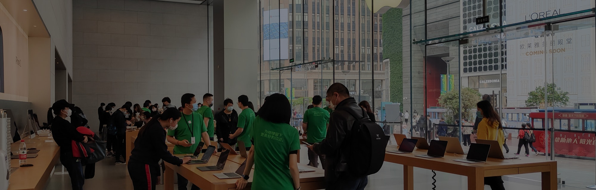 SHANGHAI, CHINA - APRIL 16, 2021 - The Apple store's LOGO lit up with green leaves to mark World Ear...