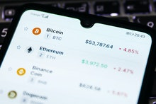 Cryptocurrencies prices are displayed on a mobile phone screen photographed for illustration photo. ...