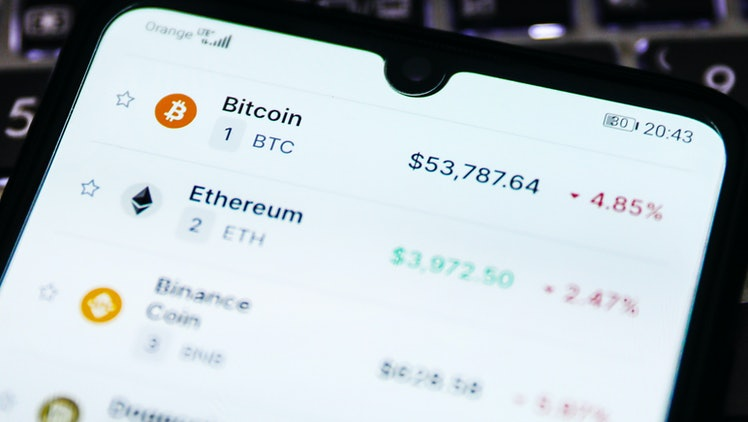 Cryptocurrencies prices are displayed on a mobile phone screen photographed for illustration photo. Krakow, Poland on May 12, 2021.  (Photo by Beata Zawrzel/NurPhoto via Getty Images)
