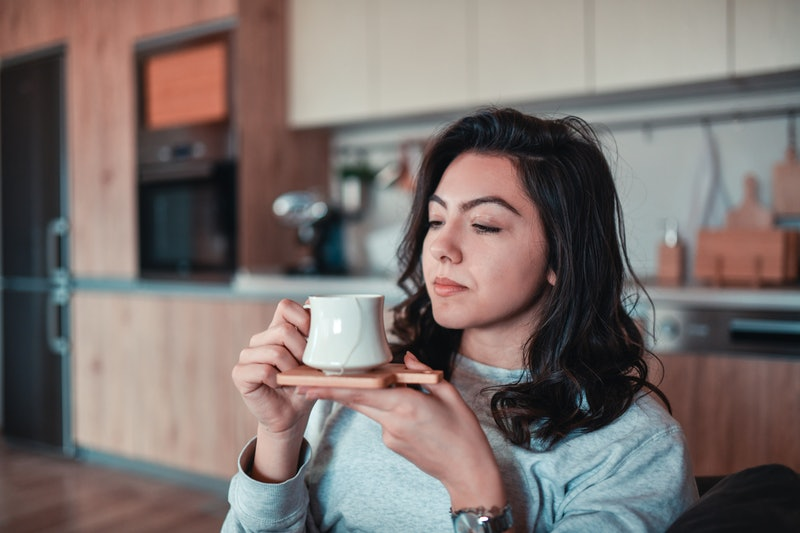 Female Dissatisfied With Coffee In Home Kitchen