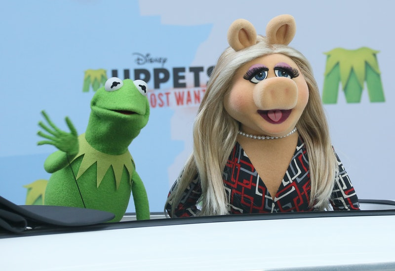 """Muppets Miss Piggy and Kermit the Frog arrive to a photocall for the movie """"Muppets Most Wanted"""" at Sony Center in Berlin, Germany, 28 March 2014. The movie comes to cinemas on 01 May. Photo: STEPHANIEPILICK/dpa   usage worldwide   (Photo by Stephanie Pilick/picture alliance via Getty Images)"""