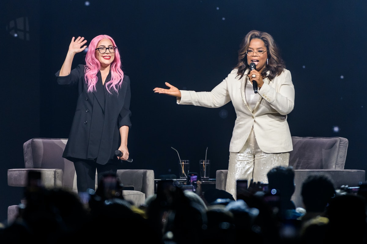 SUNRISE, FL - JANUARY 04: (EXCLUSIVE COVERAGE) Lady Gaga and Oprah Winfrey speak during Oprah's 2020 Vision: Your Life in Focus Tour  presented by WW (Weight Watchers Reimagined) at BB&T Center on January 4, 2020 in Sunrise, Florida.  (Photo by Jason Koerner/Getty Images for Oprah)