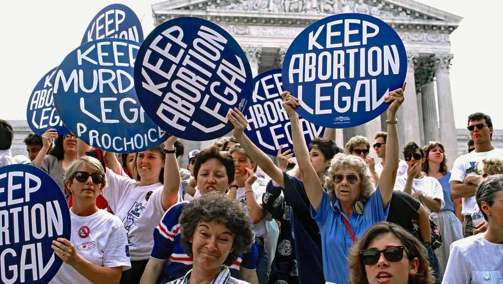 Pro-life and pro-choice demonstrators hold signs on the steps of the Supreme Court building  The protests came after the court ruled on the Missouri Webster v. Reproduction Health Services abortion case. The court's decision gave states greater power to limit abortion. Washington DC, July 3, 1989 (Photo by Mark Reinstein/Corbis via Getty Images)