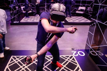 An attendee tries out the new Oculus Quest at the Facebook F8 Conference at McEnery Convention Center in San Jose, California, on April 30, 2019. - Got a crush on another Facebook user? The social network will help you connect, as part of a revamp unveiled Tuesday that aims to foster real-world relationships and make the platform a more intimate place for small groups of friends. (Photo by Amy Osborne / AFP) (Photo by AMY OSBORNE/AFP via Getty Images)