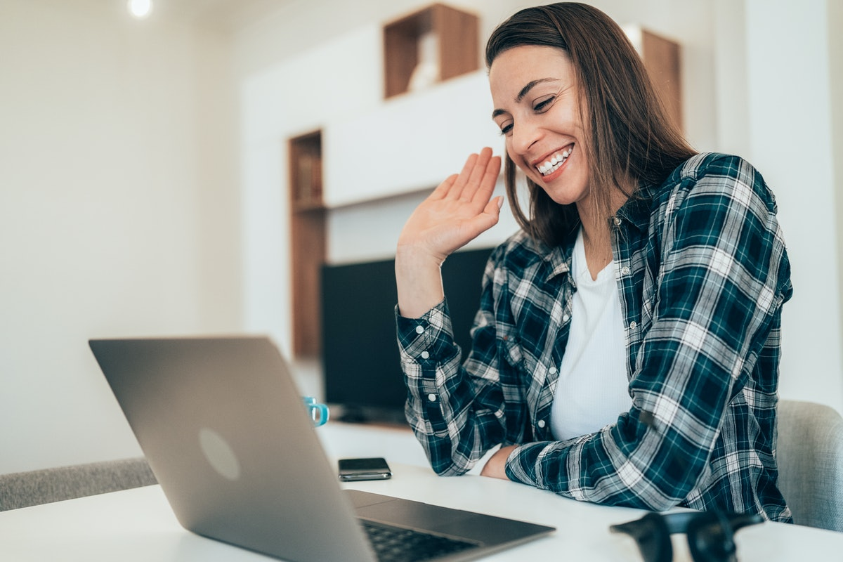 Woman starting an online therapy session.