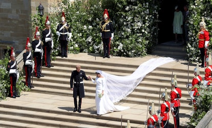 Britain's Prince Harry, Duke of Sussex and his wife Meghan, Duchess of Sussex emerge from the West Door of St George's Chapel, Windsor Castle, in Windsor, on May 19, 2018 after their wedding ceremony. (Photo by Andrew Matthews / POOL / AFP)        (Photo credit should read ANDREW MATTHEWS/AFP via Getty Images)