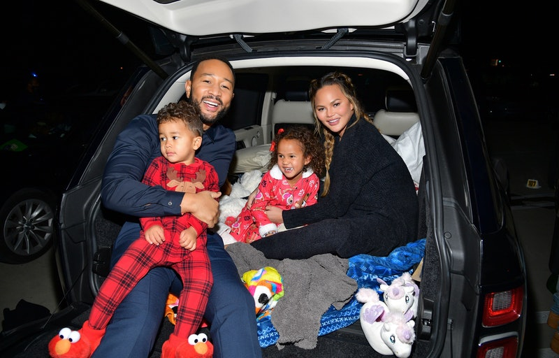 """Miles Theodore Stephens, John Legend, Luna Simone Stephens, and Chrissy Teigen attend Netflix's """"Jingle Jangle: A Christmas Journey"""" drive-in premiere at The Grove on November 13, 2020 in Los Angeles, California."""