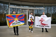 Activists of the International Tibet Network holds Tibet's flags in front of the IOC headquarters du...