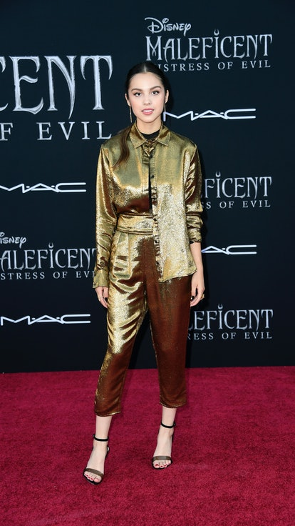 Olivia Rodrigo wears a full gold metallic shirt and pants set while attending the World Premiere Of ...