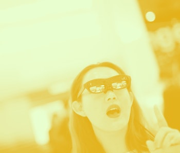A visitor tests LG augmented reality glasses with Nreal light at the Mobile World Congress (MWC) in ...