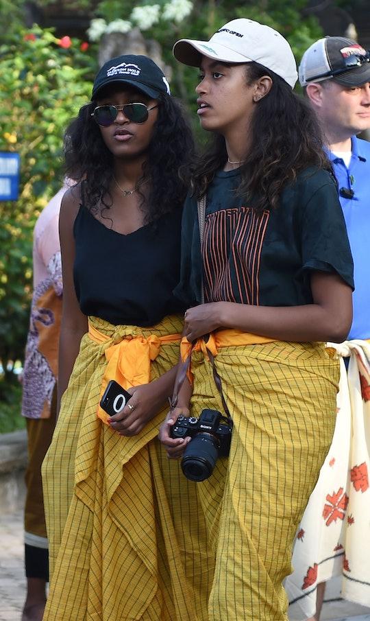 Sasha (L) and Malia (R), daughters of former US president Barack Obama, visit Tirtha Empul temple at...
