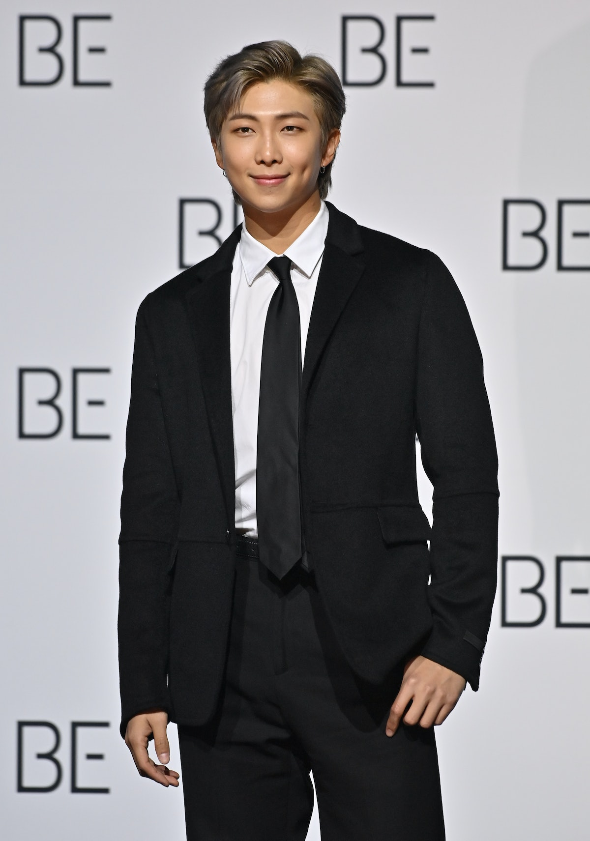 South Korean K-pop boy band BTS member RM poses for a photo session during a press conference on BTS new album 'BE (Deluxe Edition)' in Seoul on November 20, 2020. (Photo by Jung Yeon-je / AFP) (Photo by JUNG YEON-JE/AFP via Getty Images)