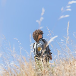 A woman walks in a wheat field questioning what her gut feeling means. Experts explain how to know i...