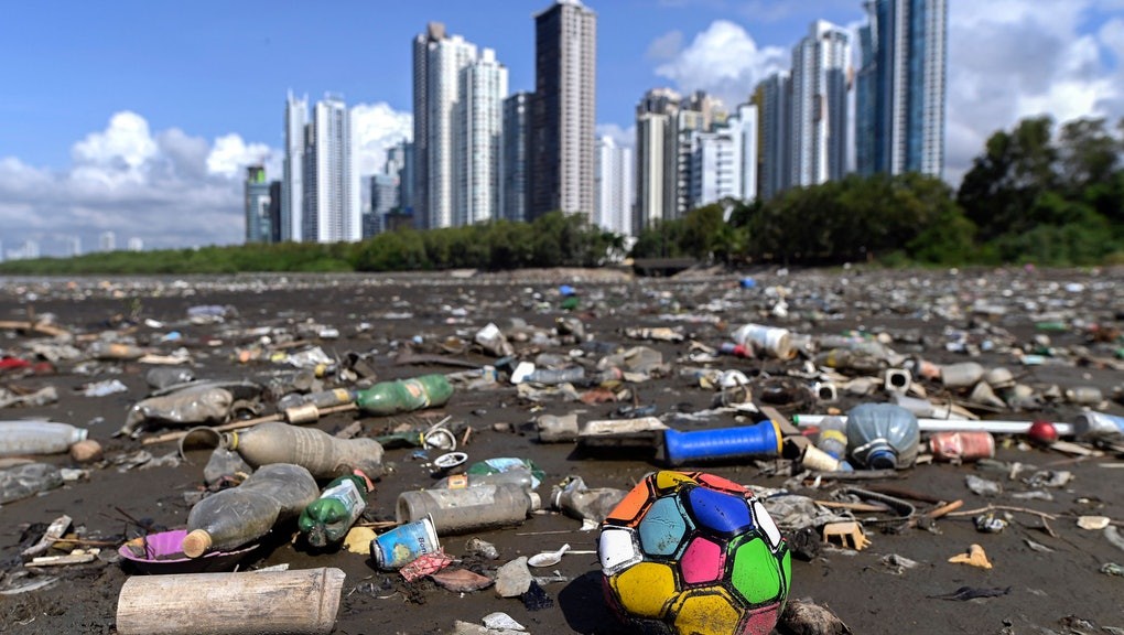 Garbage, including plastic waste, is seen at the beach of Costa del Este, in Panama City, on April 19, 2021. - Every two weeks, Marine Biology students descend about five meters in the sea to take care of a coral nursery of the staghorn species (Acropora cervicornis) in Portobelo, Panama, with which they aim to restore reefs damaged by climate change and pollution, as part of the Reef2Reef project. (Photo by Luis ACOSTA / AFP) (Photo by LUIS ACOSTA/AFP via Getty Images)