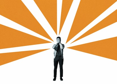 Depressed man covering face with hands while standing amidst orange rays against white background