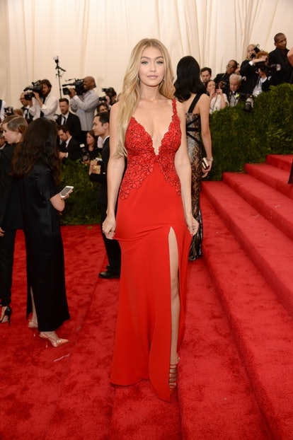 Gigi Hadid attends the 2015 Met Gala wearing a '90s-inspired slip dress.
