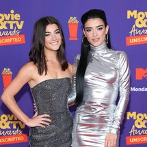 Charli D'Amelio and Dixie D'Amelio attend the 2021 MTV Movie & TV Awards: UNSCRIPTED in Los Angeles,...