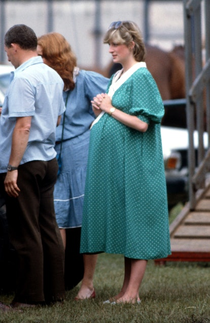 WINDSOR, ENGLAND - JUNE 06: Diana, Princess of Wales, wearing a green and white polka dot maternity dress designed by Catherine Walker and sunglasses on her head, while pregnant with Prince William, attends a polo match at Guards Polo Club on June 6, 1982 in Windsor, United Kingdom. (Photo by Anwar Hussein/Getty Images)