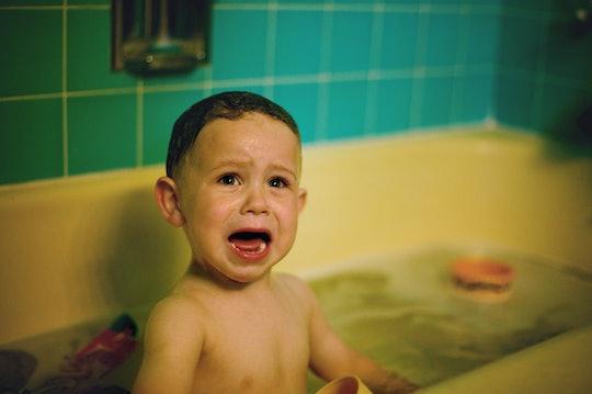 Toys in a bathtub help a toddler be less afraid of bath time.