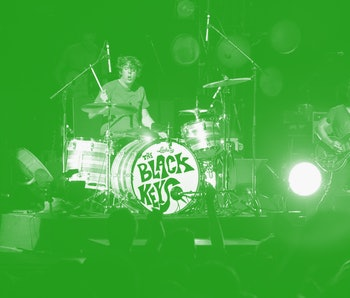 The Black Keys are shown performing on stage during a live concert appearance on July 9, 2013. (Phot...