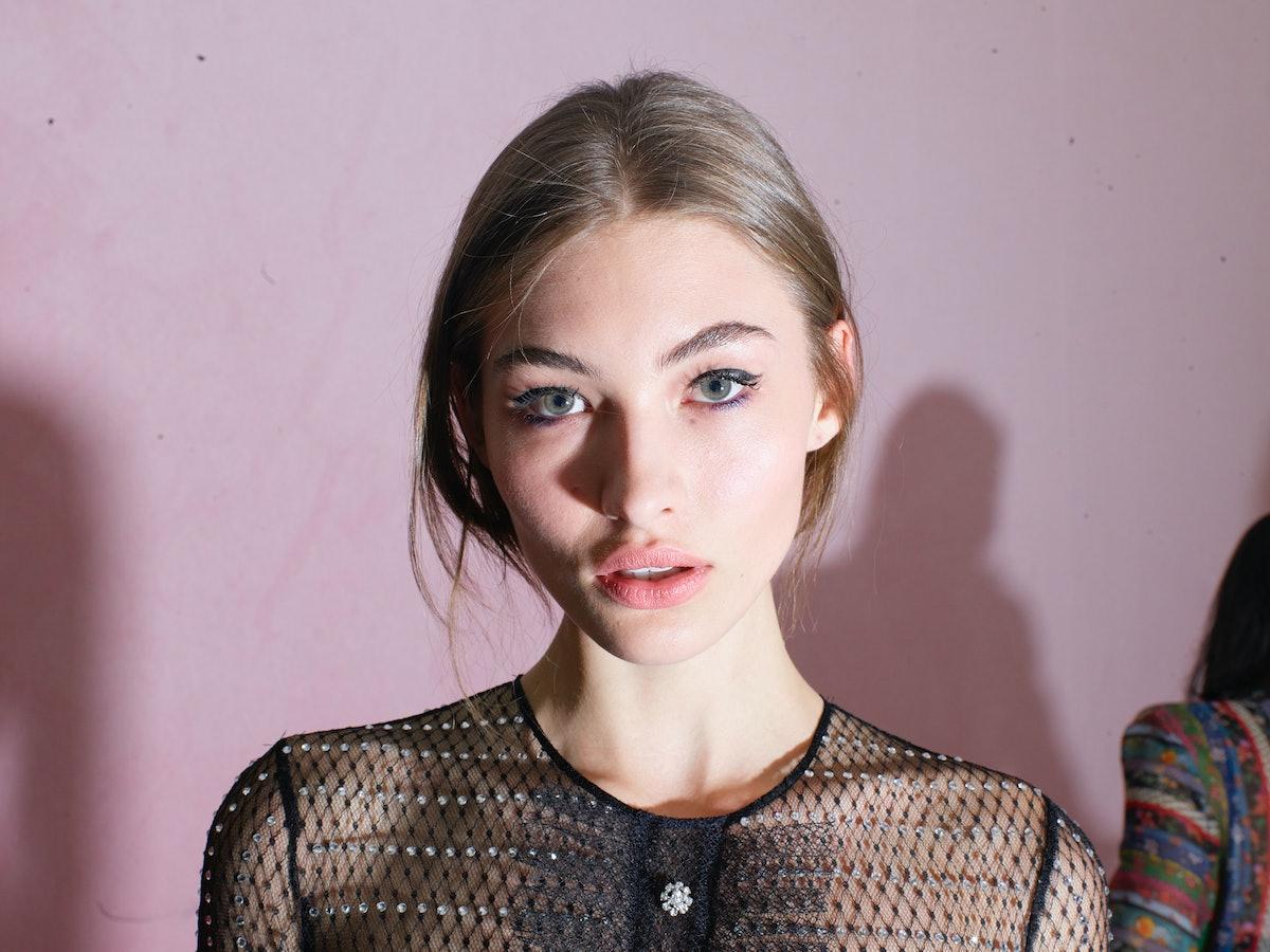 MILAN,ITALY - FEBRUARY 25:  Model Grace Elizabeth is seen backstage ahead of the Philosophy di Loren...