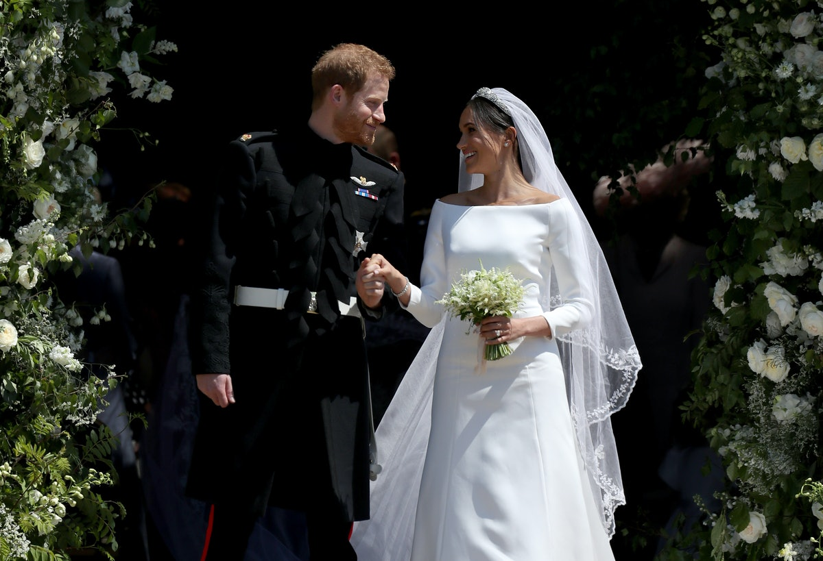 Prince Harry and Meghan Markle leave St George's Chapel in Windsor Castle after their wedding. (Phot...