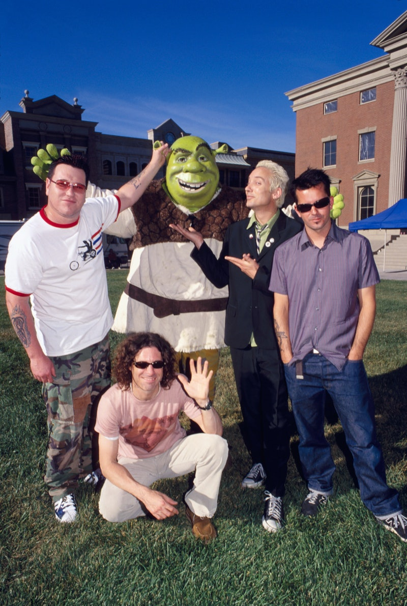 Steve Harwell, Paul De Lisle, Michael Urbano and Greg Camp of Smash Mouth with Shrek (Photo by Annam...