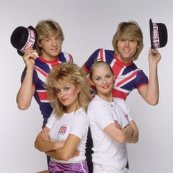 1981 Eurovision Song Contest winners Bucks Fizz. Clockwise, from the top left, the members of the group are Bobby G, Mike Nolan (both sporting Union Jack t-shirts), Cheryl Baker, and Jay Aston who won the competition with the song 'Making Your Mind Up'.   (Photo by Hulton Archive/Getty Images)