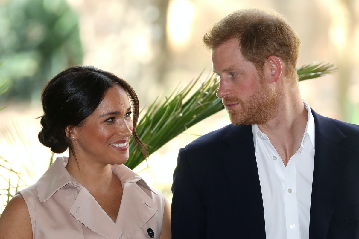 Prince Harry, Duke of Sussex and Meghan, Duchess of Sussex communicate through a smile and a glance