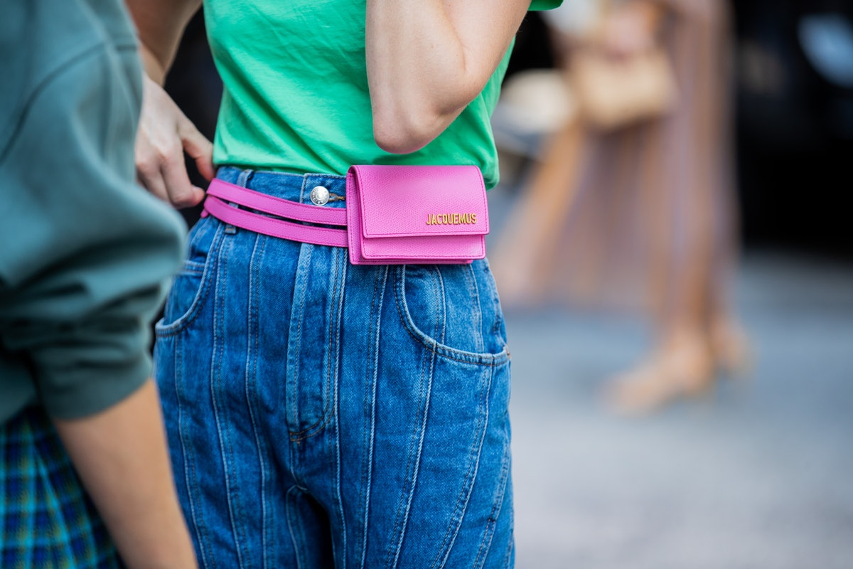 NEW YORK, NEW YORK - SEPTEMBER 09: Thora Valdimars is seen wearing denim jeans, pink Jacquemus fanny...