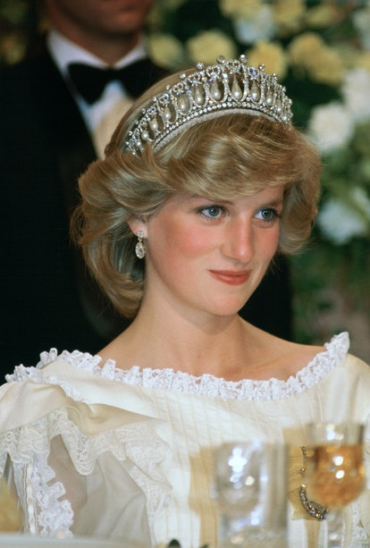 NEW ZEALAND - APRIL 29:  Princess Diana At A Banquet In New Zealand Wearing The Cambridge Knot Tiara ( Queen Mary's Tiara  ) With Diamond Earrings. Her Cream Silk Organza Evening Dress Is Designed By Fashion Designer Gina Fratini  (Photo by Tim Graham Photo Library via Getty Images)