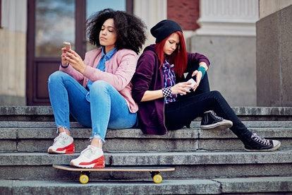 Girlfriends in conflict are texting and sulking each other