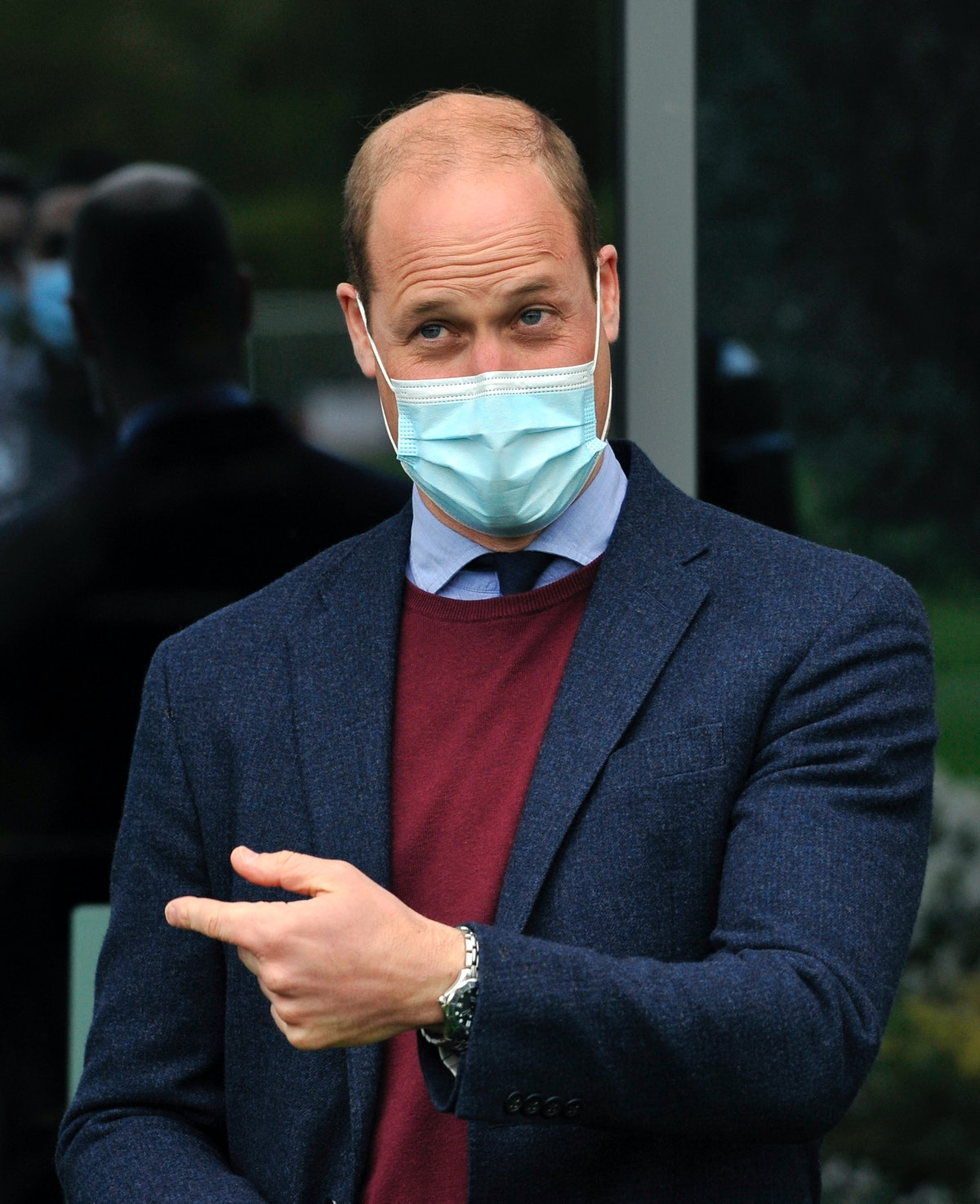 Britain's Prince William, Duke of Cambridge gestures as he meets Aston Villa football players during...