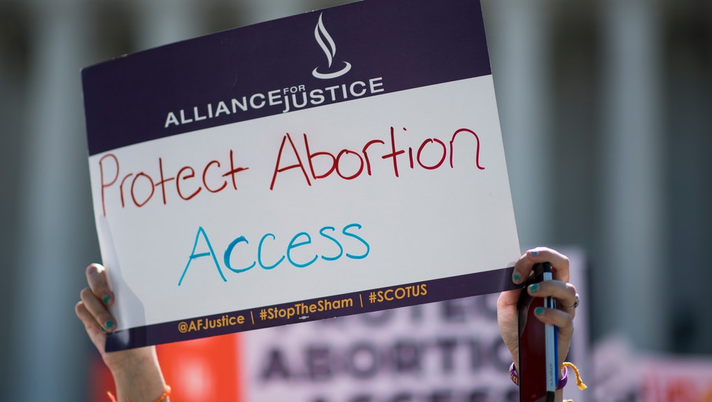 UNITED STATES - JUNE 20: Pro-choice and pro-life demonstrators rally outside of the U.S. Supreme Court on Monday morning, June 20, 2016. The court is expected to hand down their decision on a Texas law which requires clinics to meet the same standards as ambulatory surgical centers and forces doctors to have admitting privileges at nearby hospitals. (Photo By Bill Clark/CQ Roll Call)