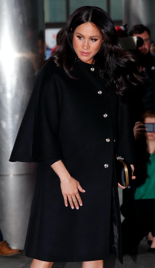 Meghan Markle wore a flattering swing coat.