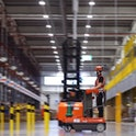 An employee works at the Amazon logistics centre in Suelzetal near Magdeburg, eastern Germany, on Ma...