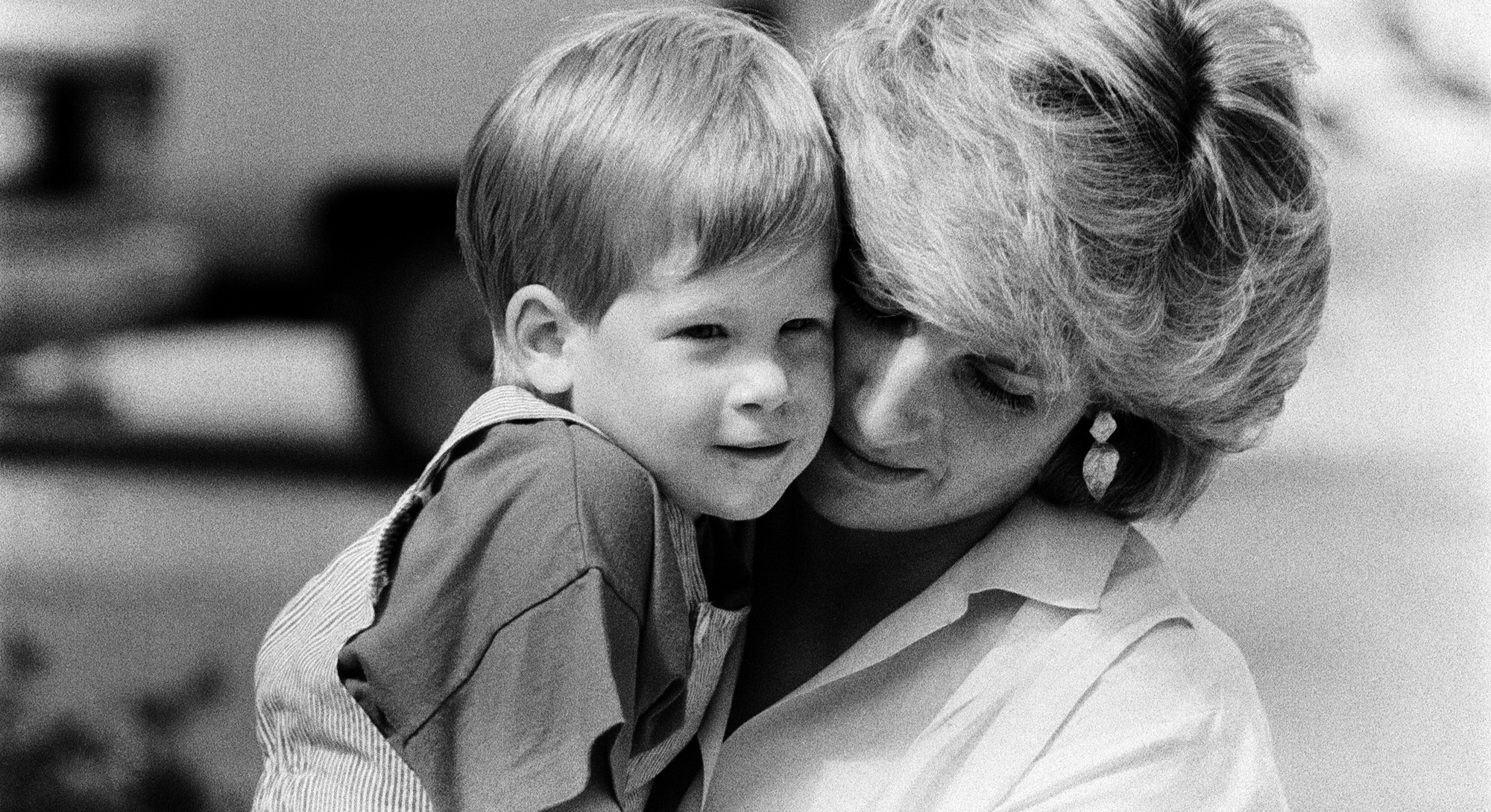 HRH Princess Diana, The Princess of Wales holds her young son Prince Harry on holiday in Majorca, Spain, Picture taken 9th August 1987. (Photo by Mirrorpix via Getty Images)