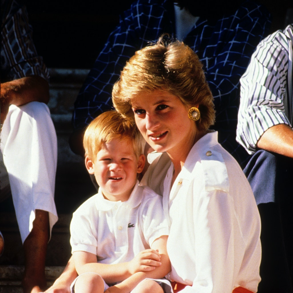 PALMA, MAJORCA - AUGUST 13:  Prince Harry sits on the lap of his mother, Diana, Princess of Wales, whilst on holiday in Majorca on August 13, 1988 in Palma, Majorca. (Photo by Anwar Hussein/Getty Images) )