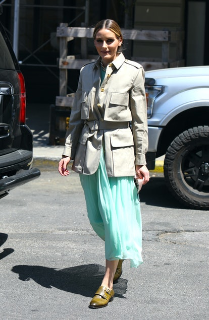 Olivia Palermo styled a chic army jacket with a turquoise midi skirt and olive brogues.