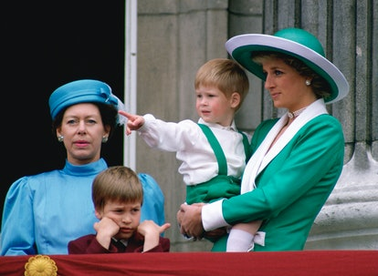 LONDON, UNITED KINGDOM - JUNE 11:  Diana, Princess Of Wales, Holding A Young Prince Harry In Her Arms As She Watches Trooping The Colour With  Prince William And Princess Margaret From The Balcony Of Buckingham Palace.  (Photo by Tim Graham Photo Library via Getty Images)
