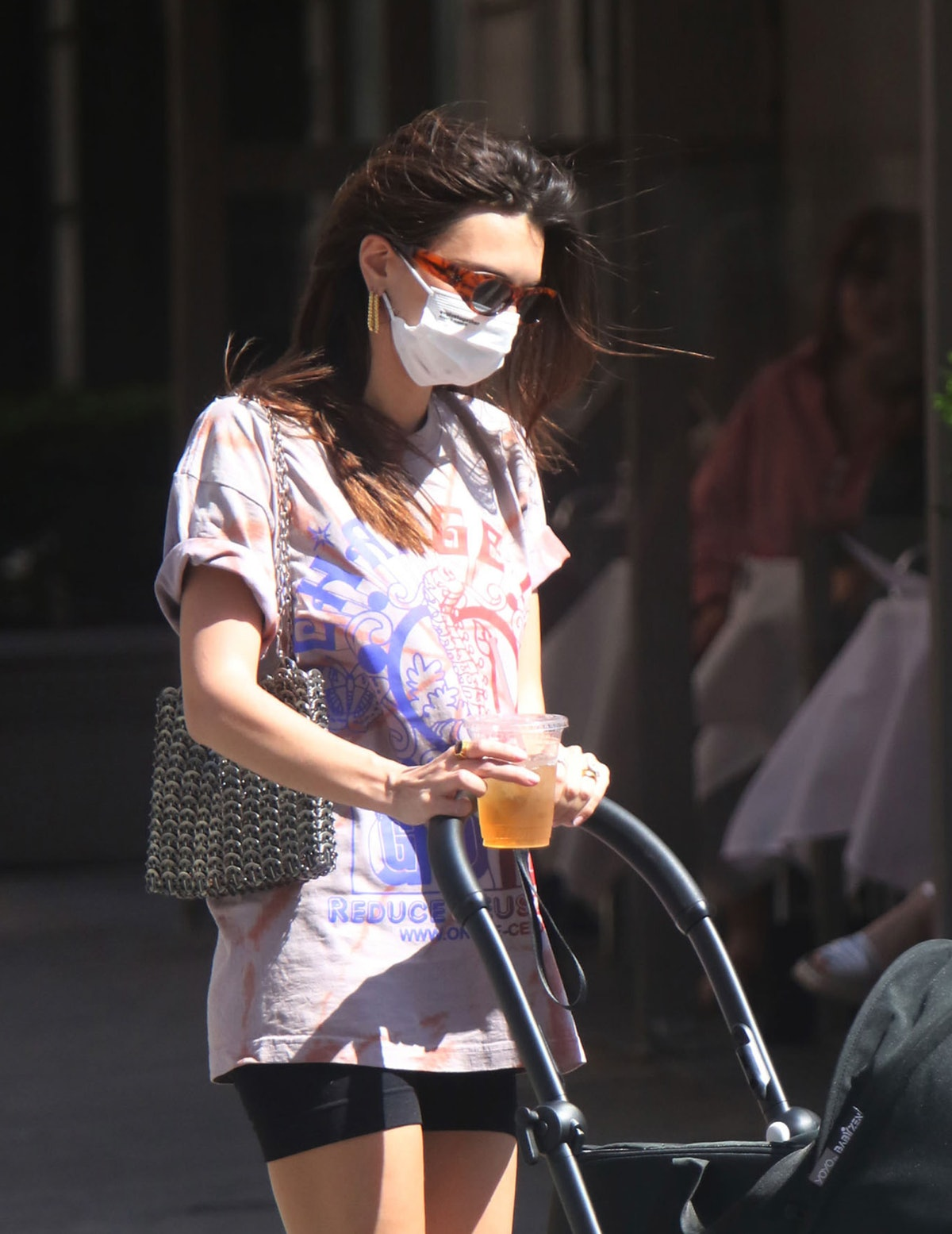 Emily Ratajkowski's oversized tee and bike shorts is serving up major summer outfit inspo.
