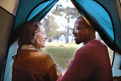 A couple in a tent. Experts explain how long it takes to love someone, depending on different factors.