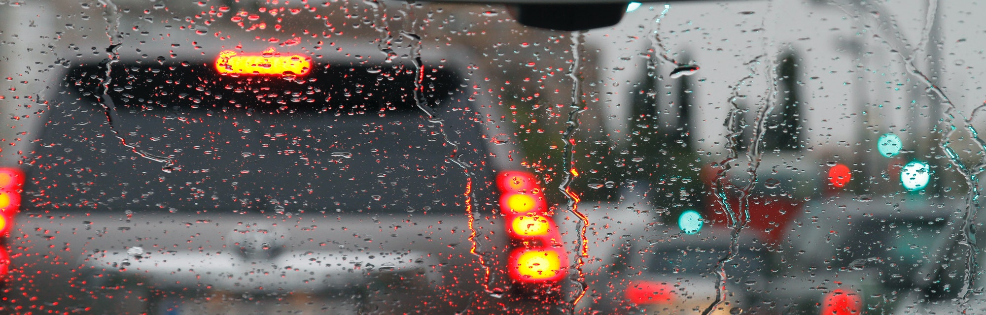 View from car with rain drops of traffic jam in the street