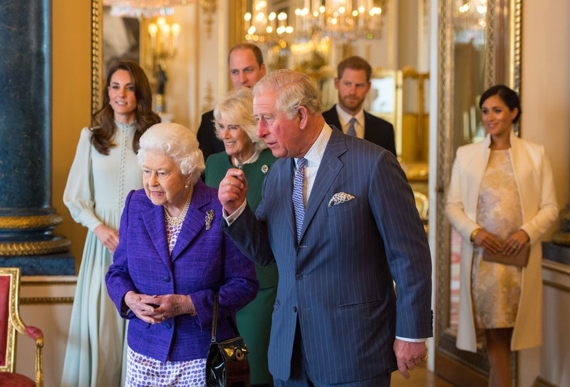 (L-R) Britain's Catherine, Duchess of Cambridge, Britain's Queen Elizabeth II, Britain's Prince William, Duke of Cambridge, Britain's Camilla, Duchess of Cornwall, Britain's Prince Charles, Prince of Wales, Britain's Prince Harry, Duke of Sussex, and Britain's Meghan, Duchess of Sussex attend a reception to mark the 50th Anniversary of the investiture of The Prince of Wales at Buckingham Palace in London on March 5, 2019. - The Queen hosted a reception to mark the Fiftieth Anniversary of the investiture of Britain's Prince Charles, her son, as the Prince of Wales. Prince Charles was created The Prince of Wales aged 9 on July 26th 1958 and was formally invested with the title by Her Majesty The Queen on July 1st 1969 at Caernarfon Castle. (Photo by Dominic Lipinski / POOL / AFP)        (Photo credit should read DOMINIC LIPINSKI/AFP via Getty Images)